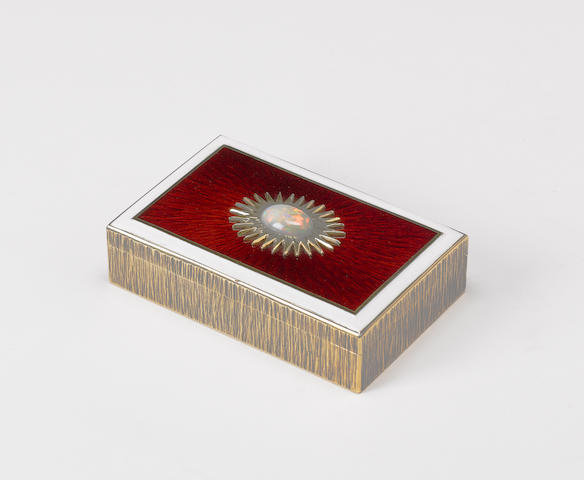 GERALD BENNEY : A silver-gilt and enamelled rectangular box, London 1974, the base with master ename