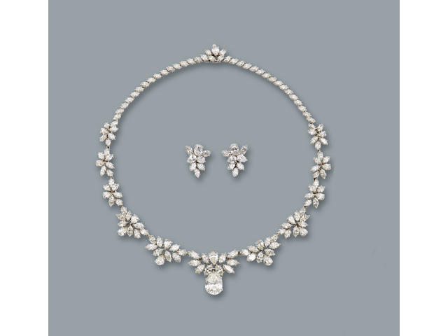 A diamond necklace and earclip suite  diamonds approximately 48.00 carats total