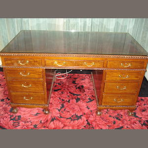 An early 20th century mahogany pedestal desk