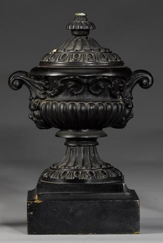 A 19th century cast iron twin handled urn