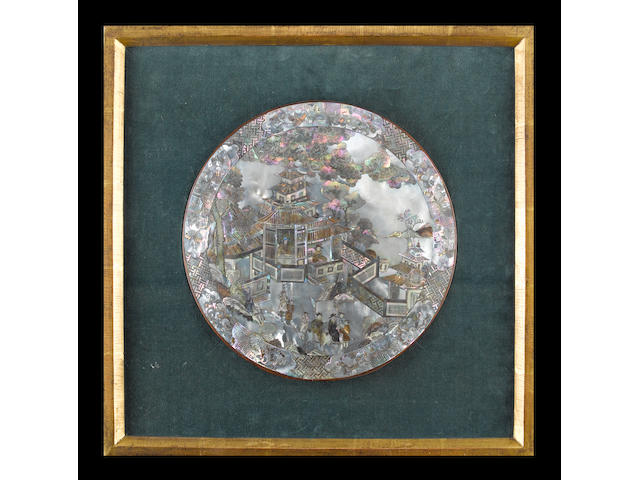 A mother-of-pearl circular plaque;