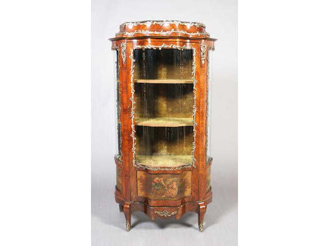 An early 20th century French rosewood and foliate cast brass mounted vitrine, of Louis XV design and of shaped outline