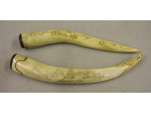 A pair of decorated ivory tusks, 8in (20cm) long
