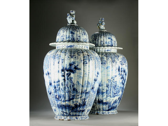 A massive pair of Dutch Delft vases and covers