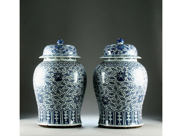 A pair of large blue and white vases and covers, 19th Century