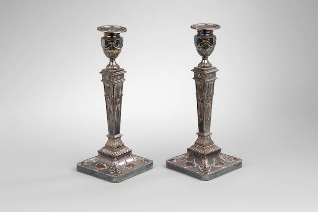 A pair of silver on copper candlesticks unmarked,
