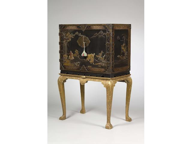 An early 18th century Japanese export black lacquer and gilt cabinet on giltwood stand