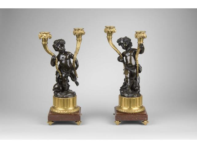 After Claude Michel Clodion (1738-1814): A pair of 19th Century French bronze and gilt bronze candelabra