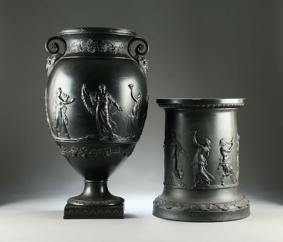 A large black basalt urn vase and associated Wedgwood stand