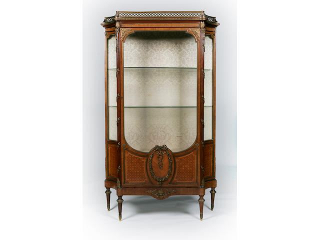 An early 20th century walnut and gilt metal mounted vitrine