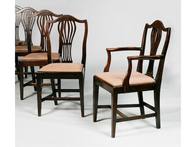 A set of nine George III style dining chairs