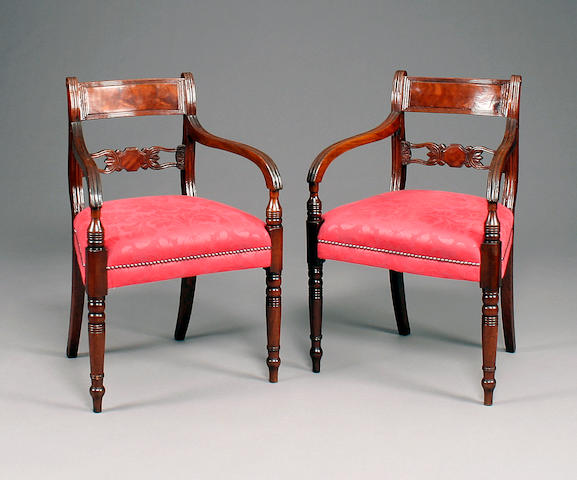 A pair of Regency mahogany open arm chairs