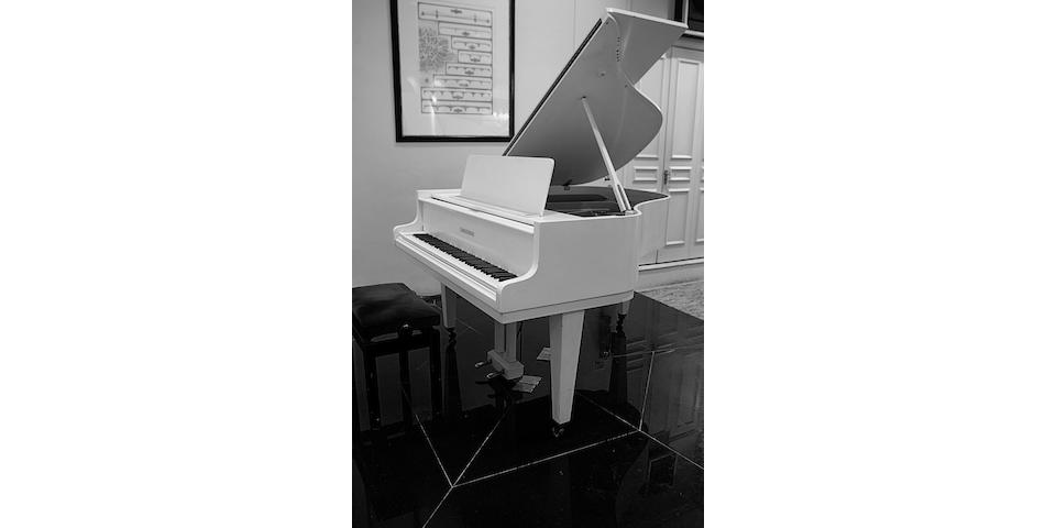 A 5ft 4in Model 160 grand piano