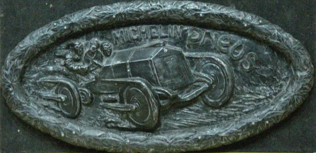 A 'Michelin Tyres' oval plaque,