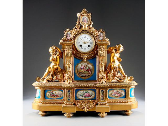 A good mid 19th Century porcelain-mounted ormolu mantel clock Raingo Freres, Paris sold with two winders, pendulum and ebonised plinth