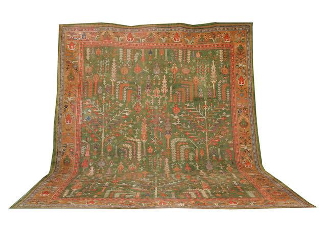An Ushak carpet 337cm x 440cm
