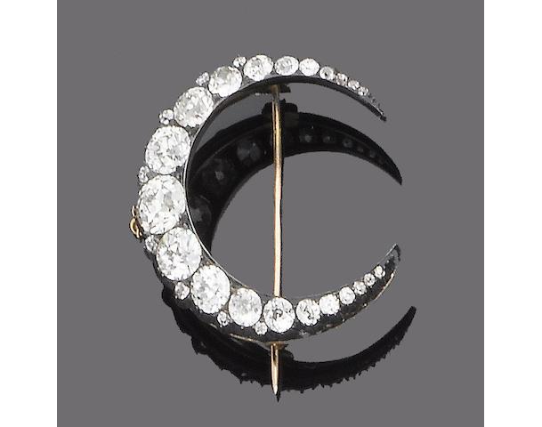 A late 19th century diamond crescent brooch,