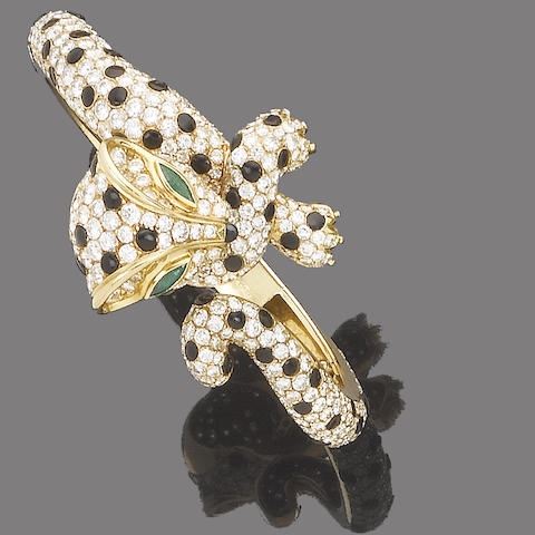 An emerald, diamond and onyx hinged bangle, by Fred