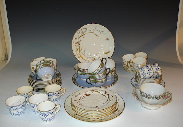 An Aesthetic part tea service decorated in gilt with butterflies,