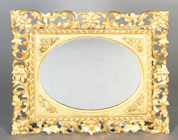 A 19th century Florentine giltwood foliate design frame of rectangular form