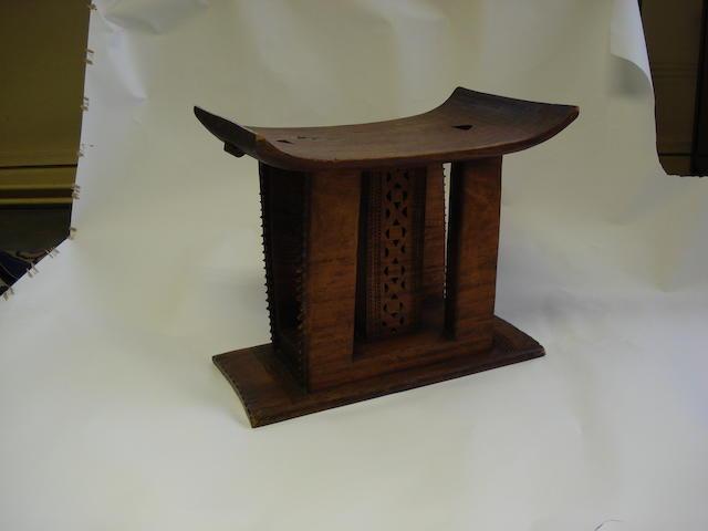 An Ashanti stool 58cm wide x 30cm deep.
