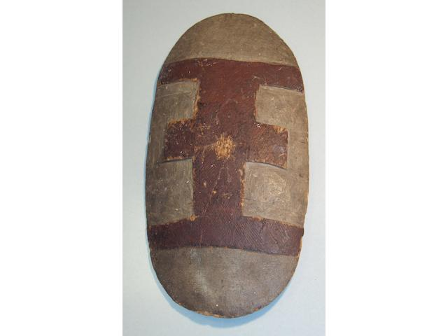 An Aboriginal carved oval wood shield,  Queensland 54 x 28cm