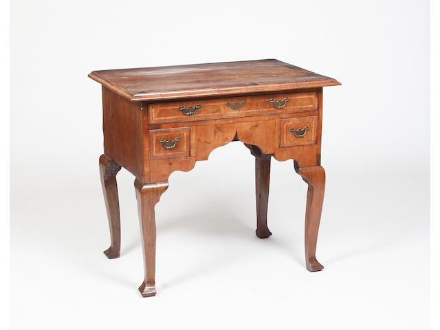An 18th century walnut lowboy