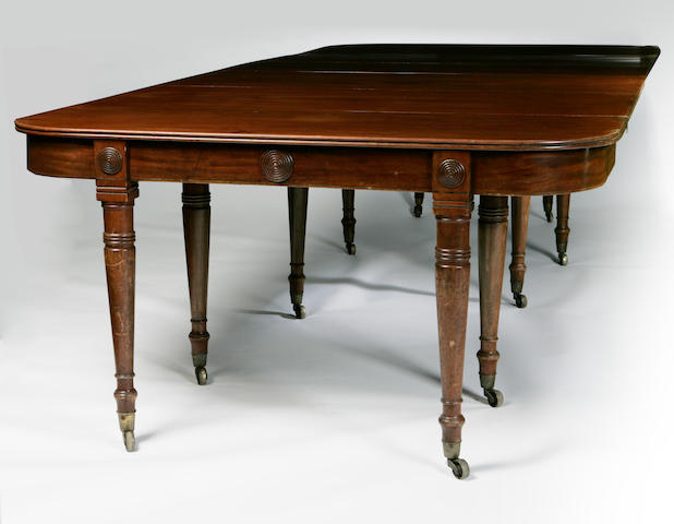 A George IV mahogany 'concertina action' dining table with five leaves