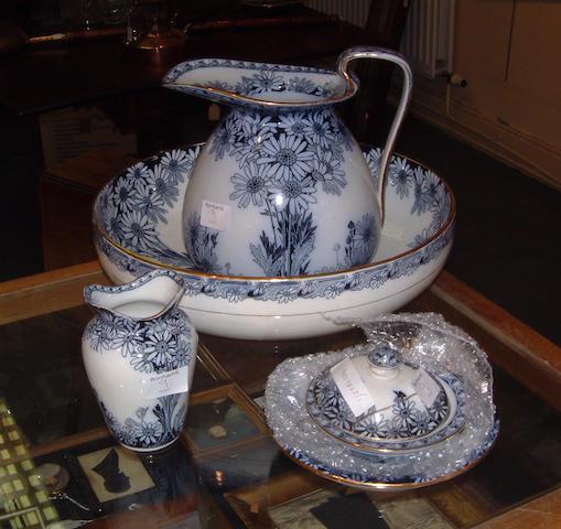 A Royal Doulton art nouveau wash set, ewer, basin, toothbrush holder, soap dish