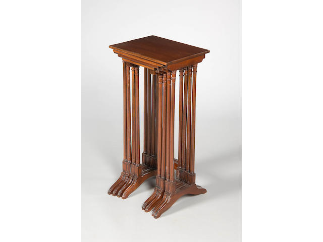 A nest of mahogany quartetto tables