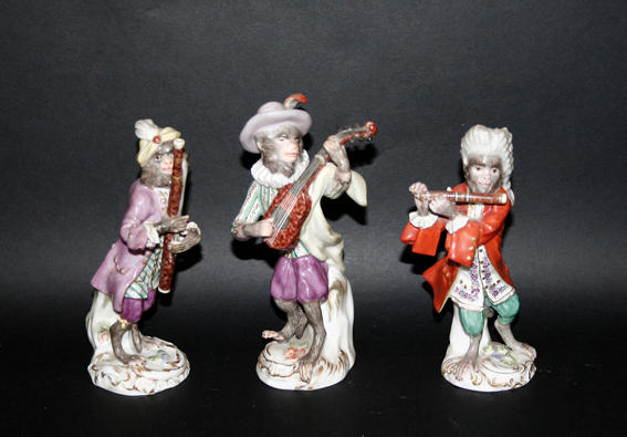 Three late Meissen monkey bandsmen