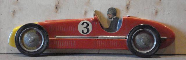 A hand painted wooden profile of a Maserati 4cl,