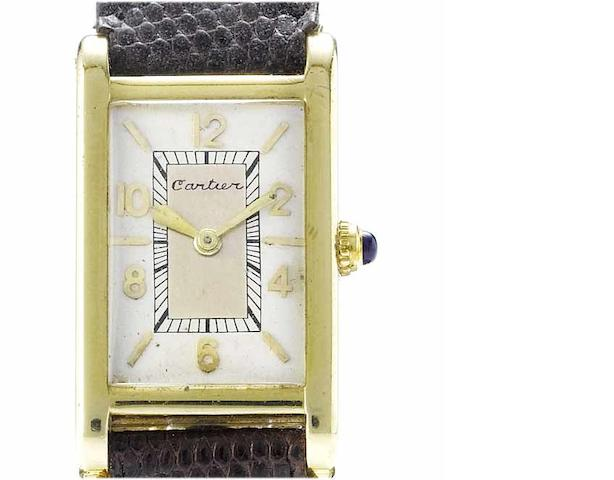 Cartier. An unusual 18ct gold rectangular wristwatch with two-tone dial and believed to be engraved for John Davison RockefellerNo.987, circa 1930