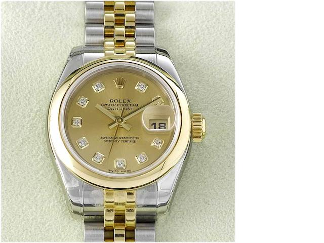 Rolex. A lady's stainless steel and gold centre seconds calendar bracelet watch with fitted box Datejust, Sold in 2005