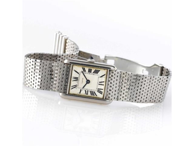 Cartier. A fine and rare 18ct white gold rectangular wristwatch with 18ct white gold Cartier braceletTank, Case No.9120, Movement No.1201761, London Hallmark for 1960