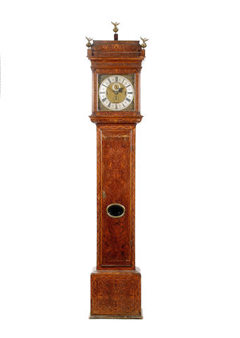 An early 18th century walnut and seaweed-marquetry cased quarter chiming longcase clock Alex. Irving, London