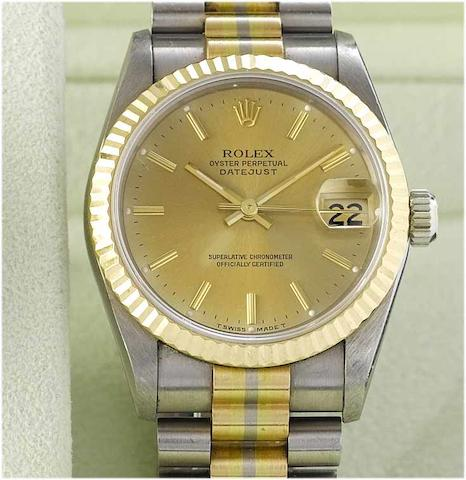 Rolex. A lady's 18ct three coloured gold mid size centre seconds calendar bracelet watch Datejust, Sold in 2000