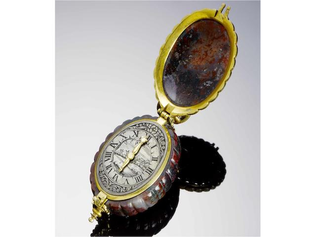 German. A fine and exceptionally rare pre-balance spring single-hand pendant watch in a carved Heliotrope case circa 1640