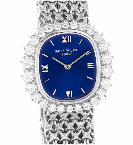 Patek Philippe. A fine lady's 18ct white gold diamond set bracelet watchRef:4137/1, Case No.2726626, Movement No.1265972, 1970's