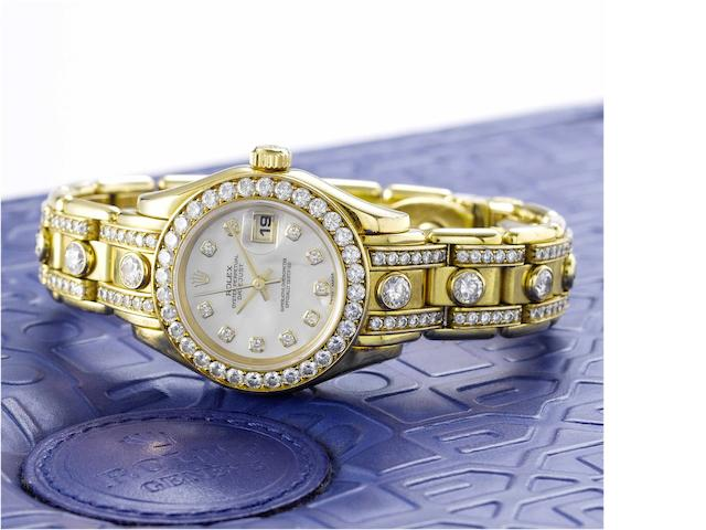 Rolex. A fine and rare lady's 18ct gold diamond set calendar bracelet watch Pearlmaster, Datejust, Sold in April 1998