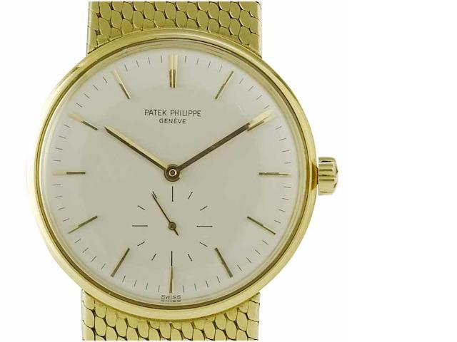 Patek Philippe. A fine 18ct gold automatic bracelet watch Ref:3425, Case No.2636860. Movement No.1114076, London Import mark for 1964
