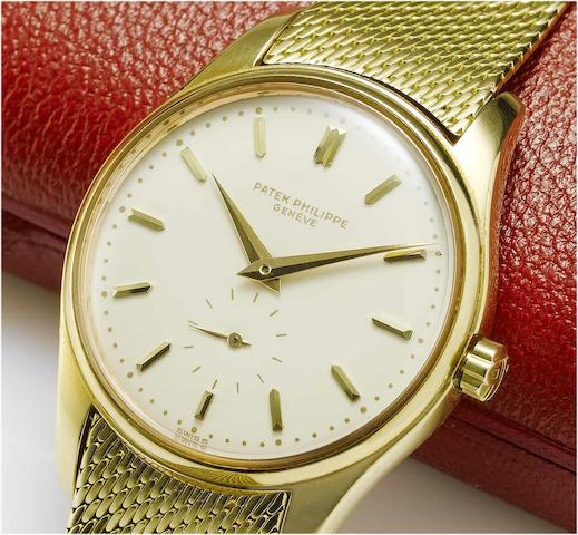 Patek Philippe. A fine and rare automatic 18ct gold wristwatch with an 18ct gold Patek Philippe bracelet, fitted Patek Philippe box and Extract from Archives   Ref:3428, Case No.26282, Movement No.1112188, London Import mark for 1962, Made in 1962, Sold June 27th 1962