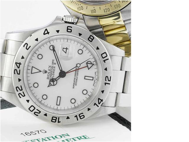 Rolex. A stainless steel automatic centre second wristwatch with 24-Hour Indication and factory box and papers Explorer II Ref:16570, Sold 21st April 1998