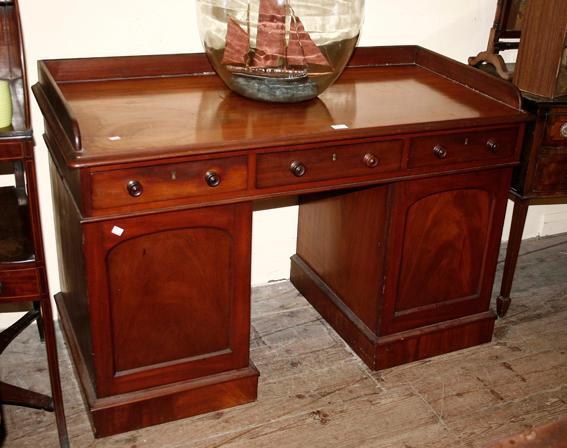 A Victorian mahogany pedestal desk,