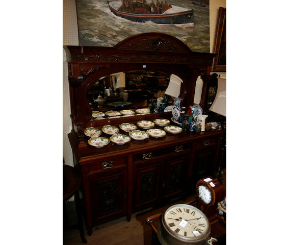A late Victorian carved walnut mirror back sideboard,
