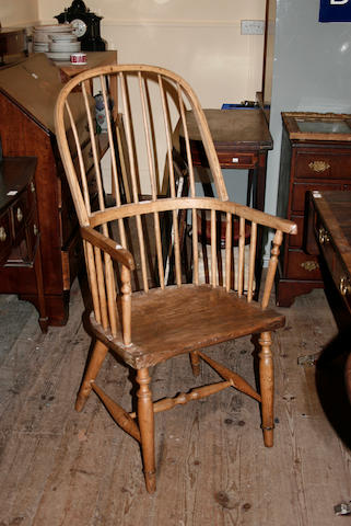 An early 19th century ash hoop and stickback armchair,