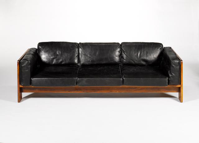 Tobia Scarpa for Knoll International, a 'Bastiano' couch, designed 1969 the rosewood frame with a brass ringed design, fitted with black leather cushions