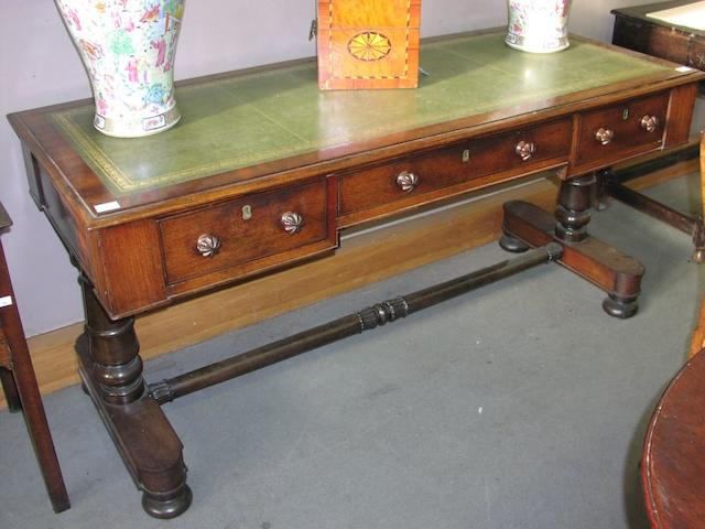 A William IV mahogany and rosewood library table,