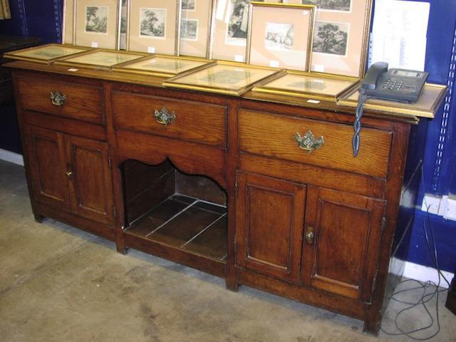 An antique oak dresser base,