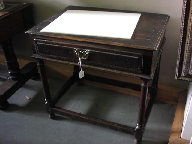 A late 17th Century oak side table,